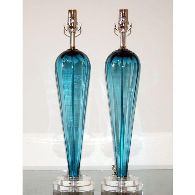 These vintage Italian teardrop lamps feature a broad shouldered silhouette in a wonderful TEAL BLUE. The glass has subtle...
