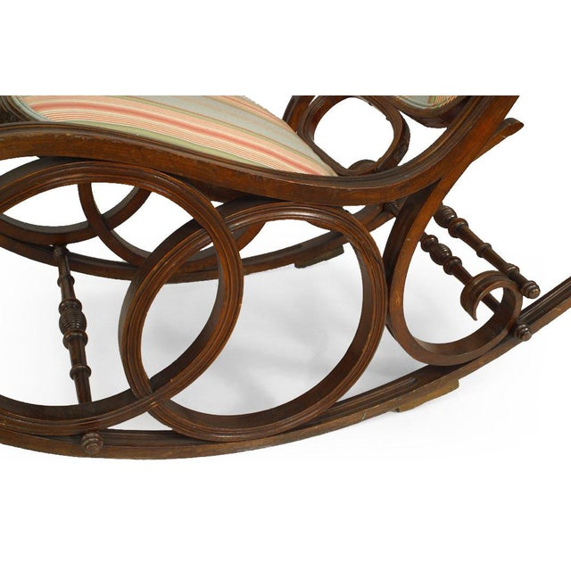 Bentwood double circle design rocking chair with striped upholstery (19th Cent.) Michael Thonet style.