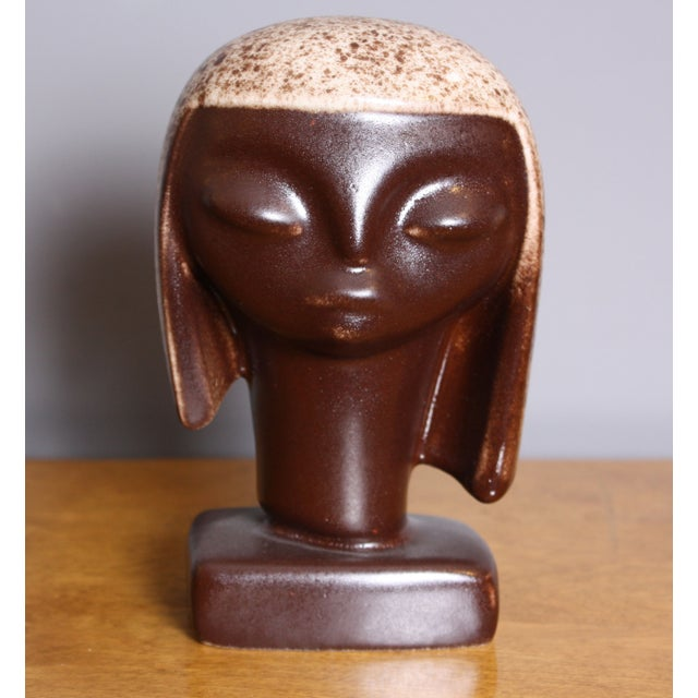 Wonderful ceramic figure from revered ceramicist, Howard Pierce's 'tribal line.' This 'tribal woman' figure is matte brown...