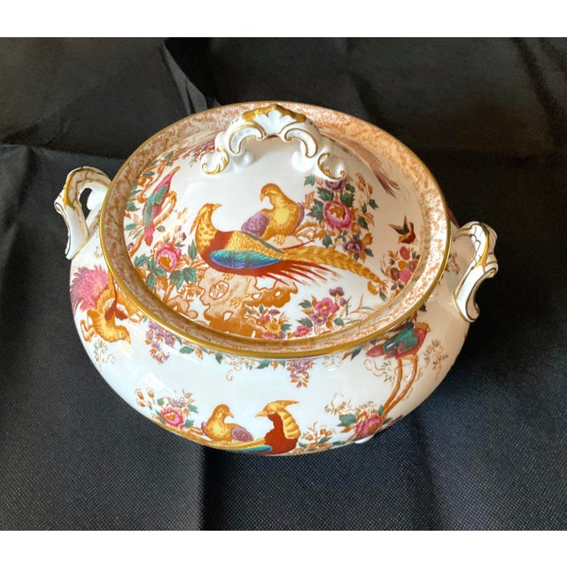 A Soup Tureen created by The Royal Crown Derby. The Olde Avesbury design found on the porcelain comes from an original...