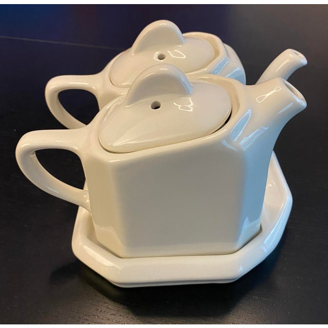 This complete 'tea for 2' set includes two small pots - one with a long spout for hot beverage (tea / coffee) and one with...
