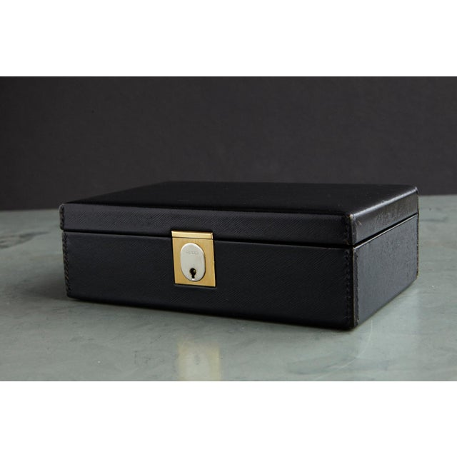 Fantastic 1980s Gucci jewelry box, made from a textured leather, it features a matte gold and silver tone push lock...
