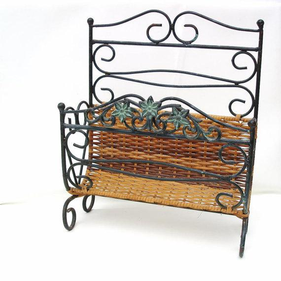 Vintage wrought iron magazine basket is made of heavy duty forged metal rods with curled iron feet. Mid century magazine...