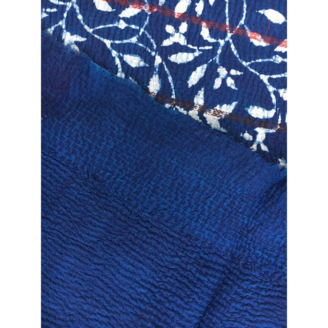 Fantastic hand stitched Kantha Quilt from India. Made with vintage saris in an indigo and white floral vine pattern with...