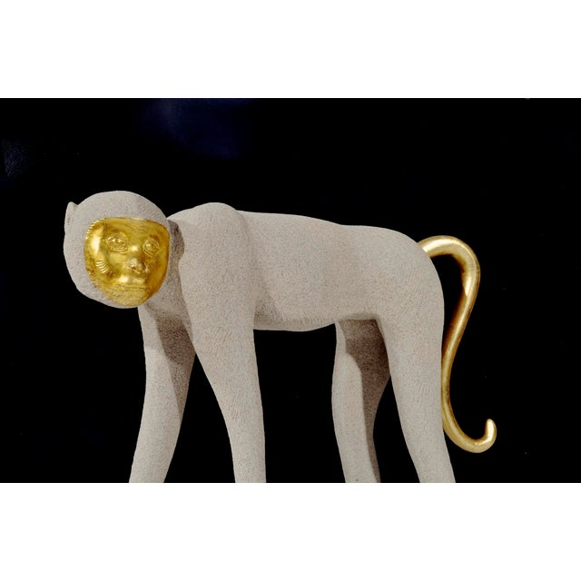 Large Walking Monkey Sculpture with expressive gilt face and adjustable tail Sandstone finish over fiberglass form with...