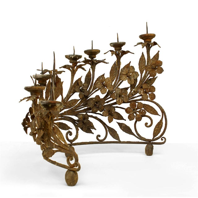 Pair of Italian Renaissance style (19th century) wrought iron eight-light candelabra in a half moon form with floral and...