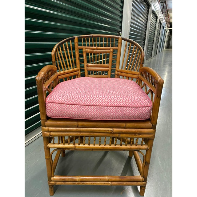 """Bamboo chairs with complex patterning and caned seats. Custom 4""""-thick cushion in Thibaut fabric is a perfect fit."""