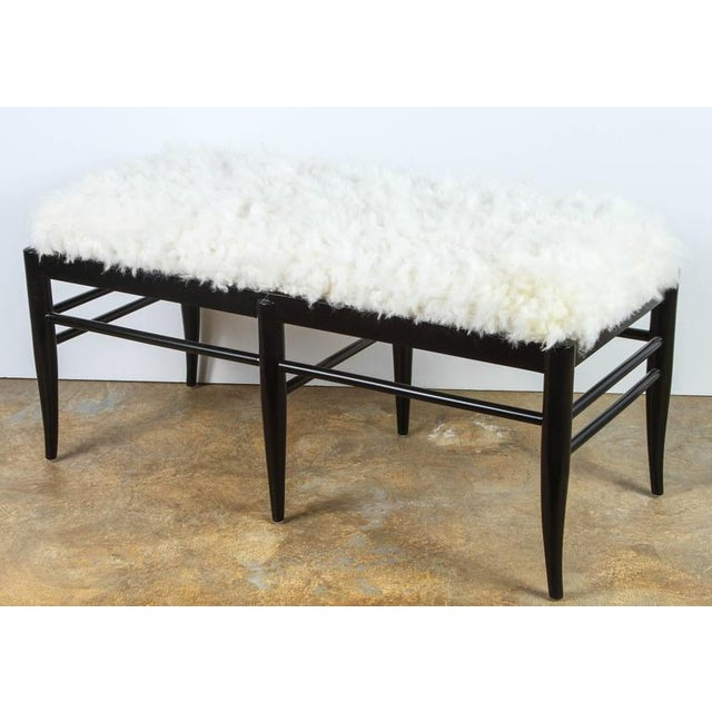 Contemporary Mid-Century Modern - style bench inspired by Gio Ponti. Upholstered in woven natural sheepskin from Denmark....