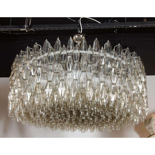 This impressive Italian chandelier consists of numerous polyhedral shades suspended in a complex interlocking cylindrical...