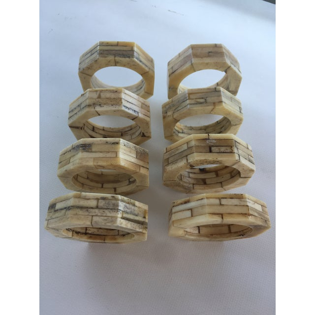 Set of eight natural ivory bone inlaid octagonal shaped napkin holders. Excellent condition.
