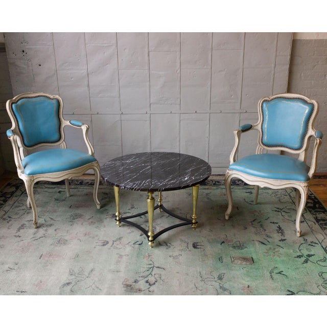 Handsome set of 4 Louis XV style armchairs in blue leather with gold tooling. The frames have the original distressed...