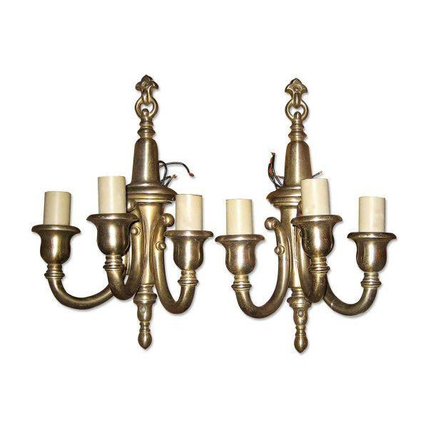 This is a pair of triple arm wall sconces with a nickel finish over bronze. Priced as a pair.