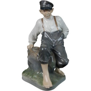 Royal Copenhagen Shepherd Boy on Rock Figurine