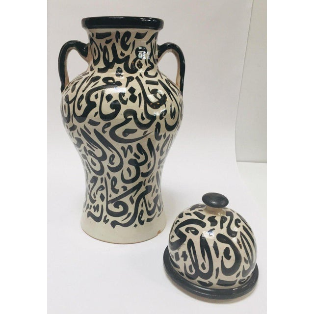 Pair of Moroccan glazed ceramic urns from Fez. Moorish style ceramics handcrafted and hand painted in Fez with Arabic...