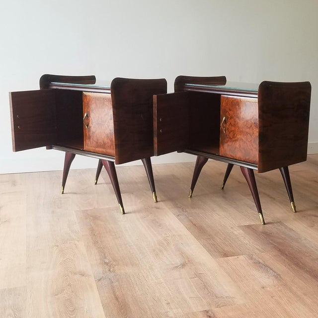 A stunning pair of 1950s Italian burl walnut nightstands with glass tops. The design closely resembles the work of Italian...
