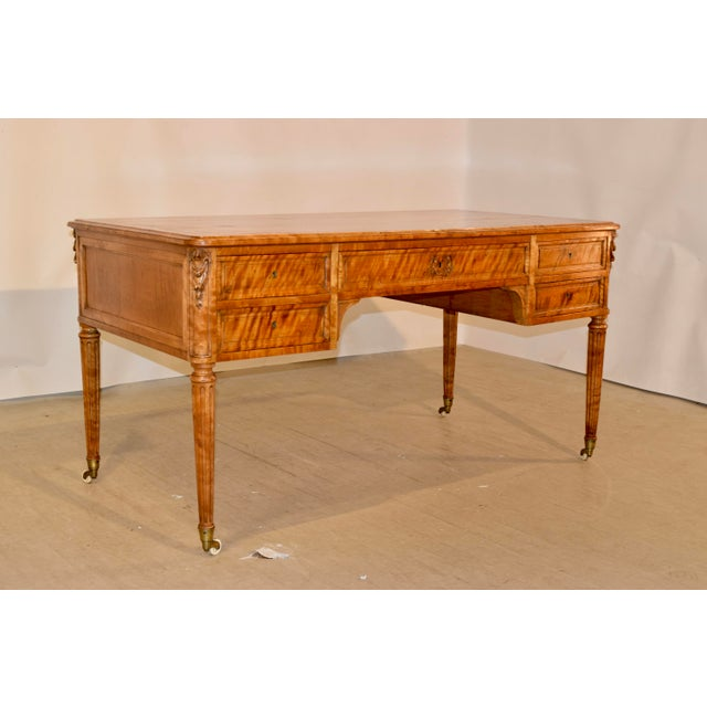 19th Century rare desk from England made from exquisite flame satin birch. The entire desk appears to be alive with the...
