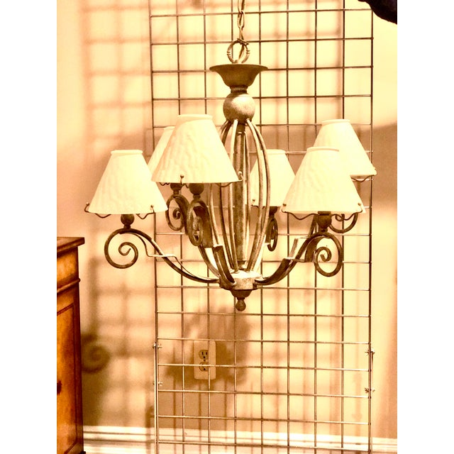This 6 arm lighting fixture features a subtle patina that gives character to the piece. It comes from an immaculately kept...