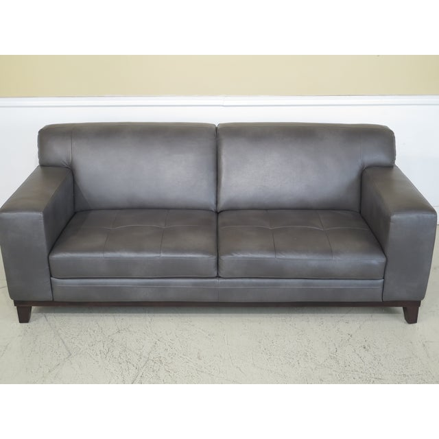 Item: 43683EC: Modern Grey Leather 2 Cushion Sofa Age: Approx. 10 Years Old Details: Quality Construction Modern Design...
