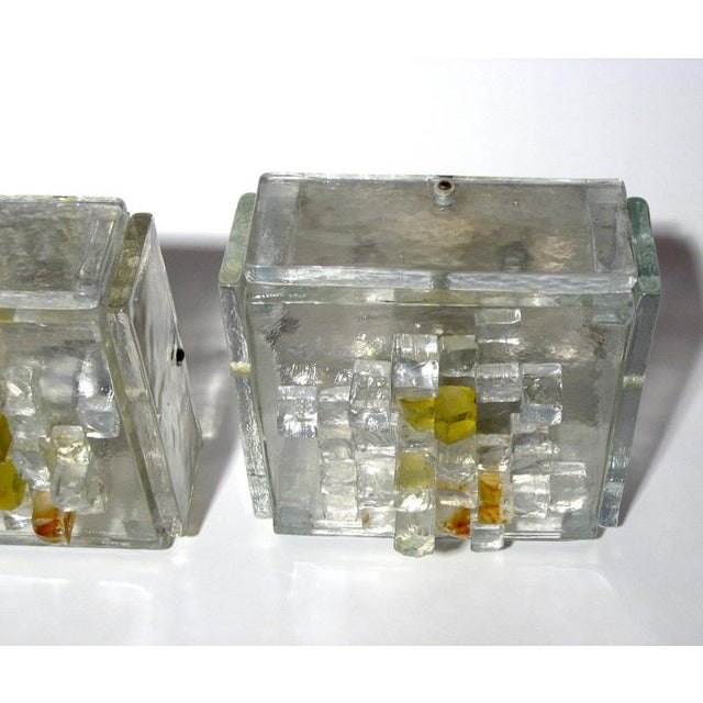 A pair of wall lights, cut glass structure, amber and clear, design by Poliarte ca.1970s Conditions : perfect MEASUREMENTS...