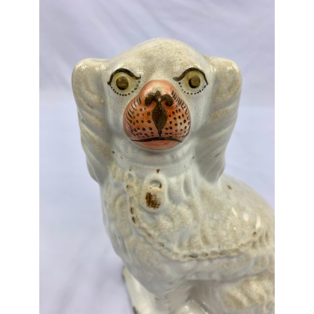 Gorgeous antique white staffordshire dog dating to late 1800s. From his peach tone snoot to his lock and key detailing...