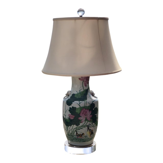 This lamp was made from a late 19th century Chinese vase. The handpainted colors are vibrant. The vase is mounted on a...