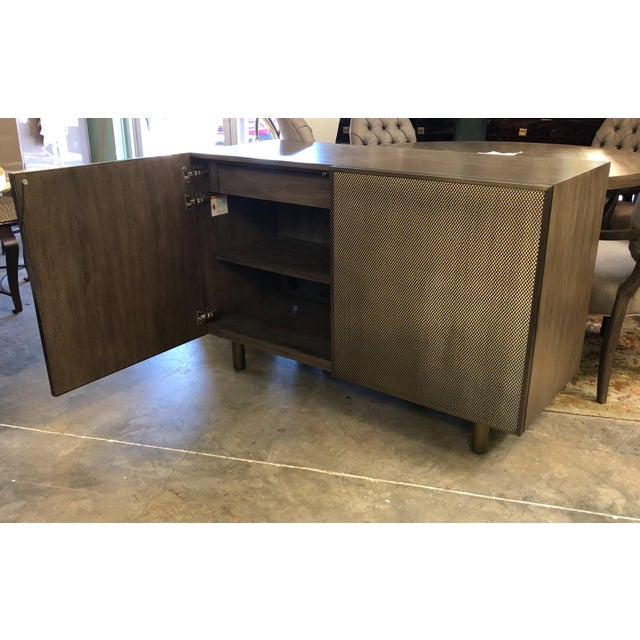 Add a little pizazz in your room with this modern sideboard. Brings you back to the era of glamour. Behind each door it...