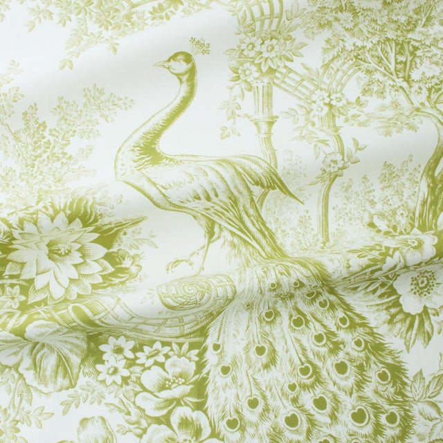 Peacock Toile is an elegant depiction of a classic 19th century French pattern, printed on a fresh cotton ground,...