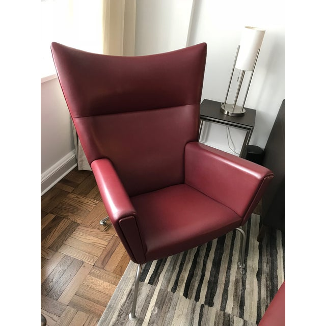 Hans J. Wegner for Carl Hansen & Søn Burgundy Wingback Chair and Ottoman For Sale - Image 11 of 11