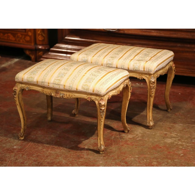 Use this elegant pair of antique stools for extra seating in your den! Crafted in France circa 1890, the rectangular...