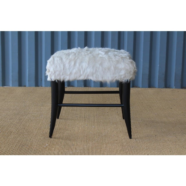 Custom made croft stools by Hollywood at Home. Ebonized base with an upholstered seat in white cowhide. Sold individually.