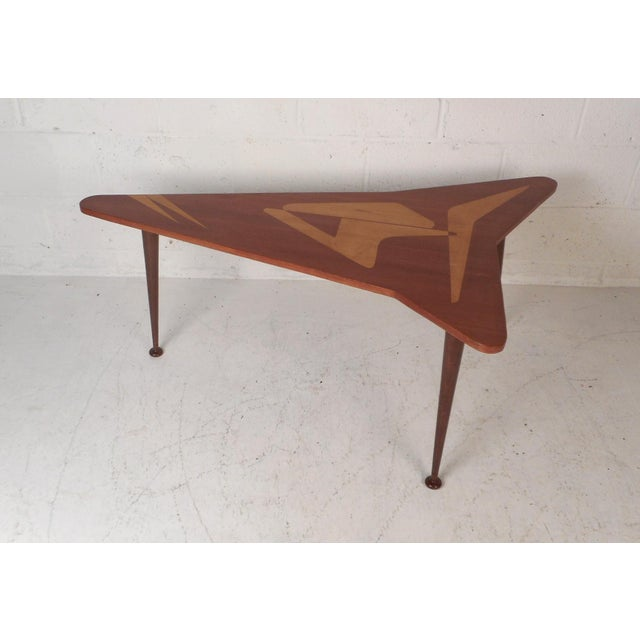 A gorgeous midcentury style coffee table with a boomerang shaped top. Lovely two-tone design with unique inlays on the top...