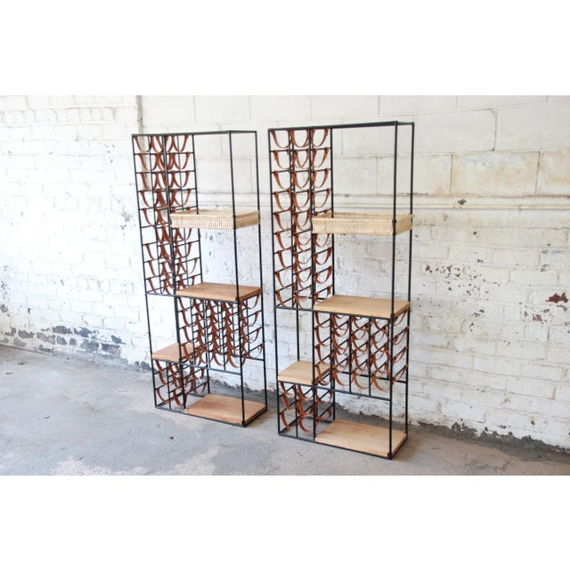 Offering an exceptional and rare pair of 40-bottle wine racks designed in 1954 by Arthur Umanoff for Shaver Howard. The...