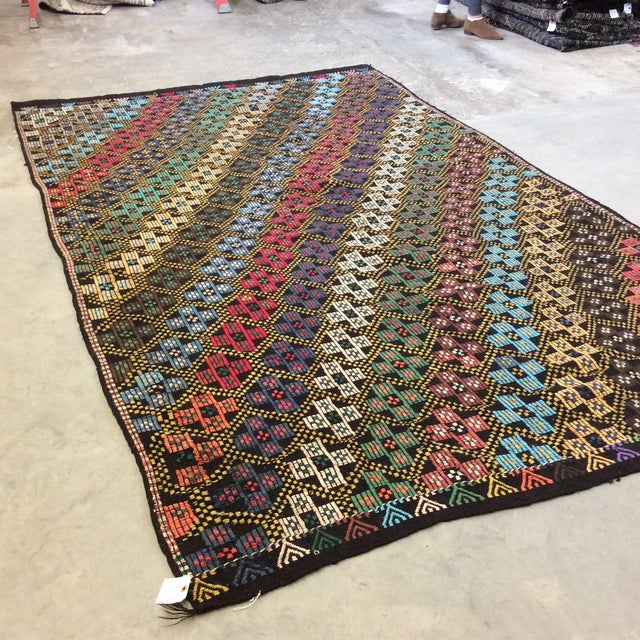 Beautiful and colorful Kilim in a diagnonal and cross pattern. Colors are bright. This is a larger Kilim, so check your...