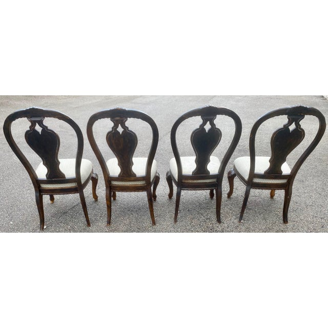 Vintage Carved Wood Chairs Set of 4 upholstered wit ornate legs.