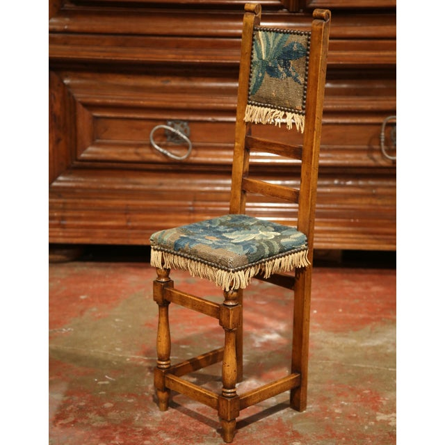 This beautiful, antique children's chair was created in France, circa 1760. The small fruitwood child sized chair has...