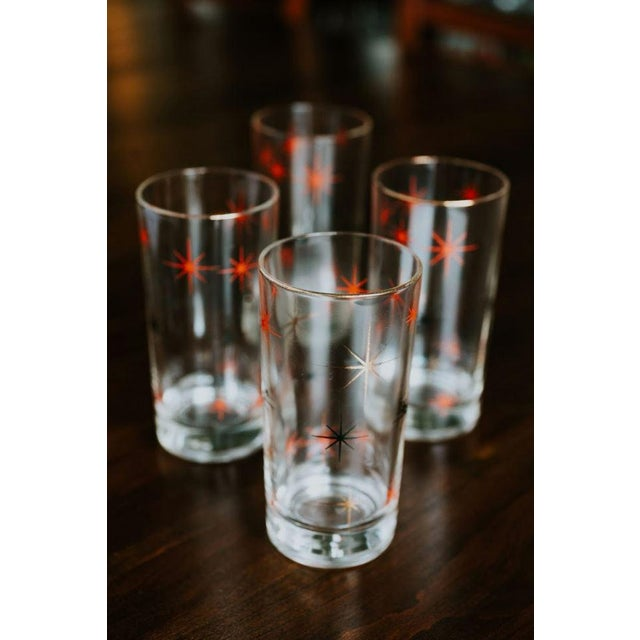 (4) Mid Century Starburst Glasses Black/Red/Gold Fun retro pattern. Dims: 5.5hx2.75w