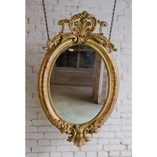 19th century oval mirror, gold leaf gilded in the style of Louis Philippe, Provenance France This 19th Century Mirror is...