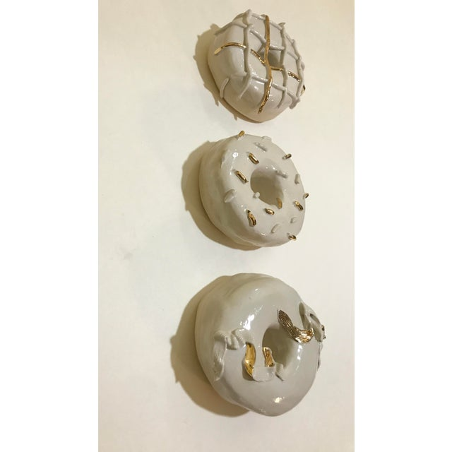 This is a limited edition of handmade stoneware clay donuts with real gold luster. Each donut I form out of a slab (flat...