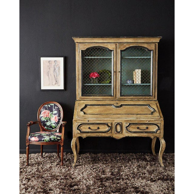 Remarkable two-part secretaire bookcase featuring a slant drop front desk. Made in the Swedish Gustavian taste with a...