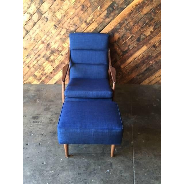 Custom mid-century blue lounge chair and ottoman. Made of walnut wood, this chair and ottoman set has a beautiful design...