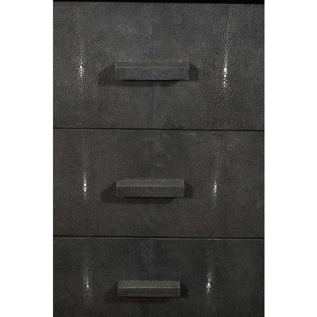 Custom shagreen drawer front dressers with ebonized frame.