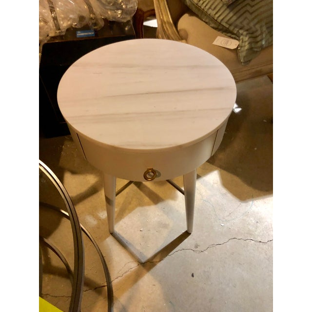 A round wood base and a solid marble top make this Side-table/Nightstand a well-rounded part of your bedroom. Its top is...