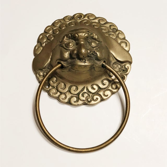 This heavy brass foo dog works perfectly as a door knocker or could be used in a bathroom as a towel ring. Screws are not...