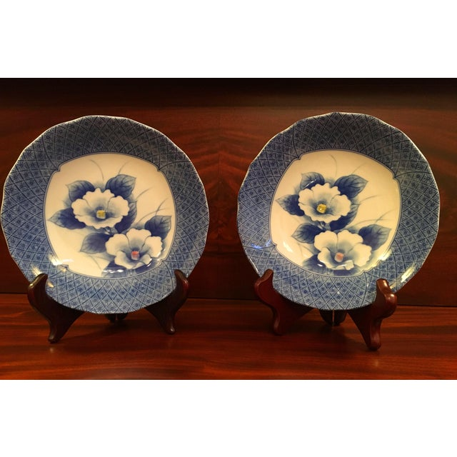 Delicate, exquisite bowls for serving or display. A lovely blue diamond and floral border frames two beautiful white...