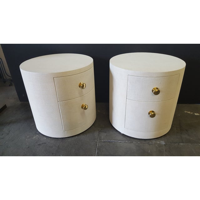 "Linen-wrapped Paul Marra Italian inspired round nightstands. Shown 26""diameter. Light cream linen. Refer to last image of..."