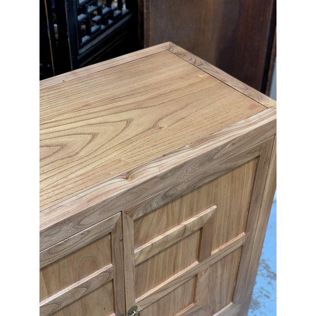 Key design cabinet with 4 doors, antique brass ring hardware, a removable shelf for storage, and a natural finish.