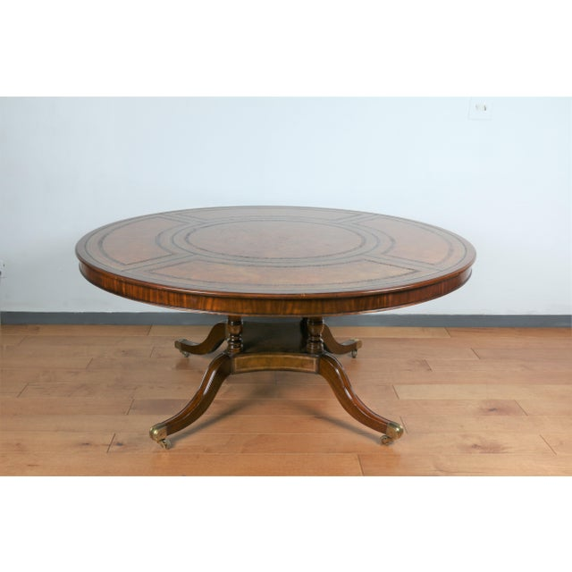 Vintage Maitland Smith Huge Round Dining, conference or center table in good condition. Table has a beautiful leather top,...