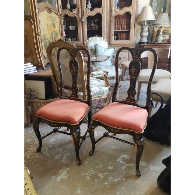 Stunning pair of antique side chairs with Chinoiserie decorations....most likely English and late 19th century. The fabric...