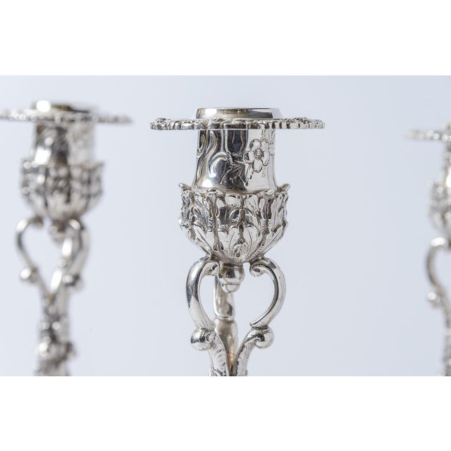 Set of four sterling silver candle sticks Samuel Kirk & Sons, Inc. Baltimore, Maryland. Circa 1925-1932 . Highly chased...