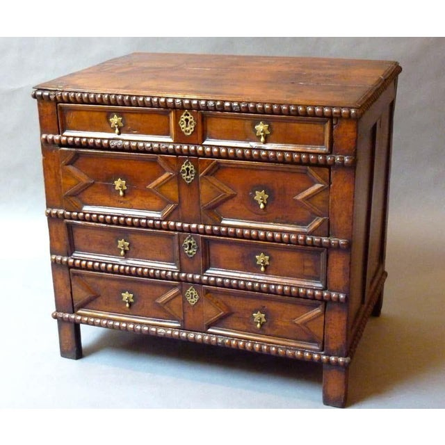 Extremely rare 17th century English moulded chest of drawers made of solid cherry wood with a rich color and deep lustrous...